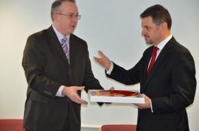 John Vinney presents Zoran Stavreski with a Poole Pottery plate as a memento of the Deputy Prime Minister's visit