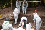 Students excavate the simulated mass grave